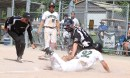 Tavistock Athletics' pitcher Liam Laforest is safe at home, but sent back to third on a controversial call against New Hamburg.