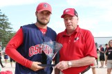 Oshawa Captain Josh Maguire accepts the runner-up trophy from Softball Canada Asst. Supervisor Bob Abbot.