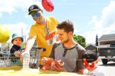 "Mike's valu-mart store manager Chris Edwards serves water to Jimmy Donkers and his two sons, Oscar, 1, and Charlie, 3, at the charity barbecue held on Saturday, August 6, 2016 between 11 a.m. and 2 p.m. Lots of balloons and face painting by Hannah Cole added to the atmosphere. The event raised $400.70 for T.A.P. ""It was a great day,"" Chris said."