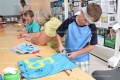 Morgan George makes his tote bag during the craft session at Vacation Bible School last week.