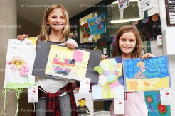Tavistock Public School Grade 5 student Samantha Roth, left, and Grade 4 student Tori Burchatzki, display their first prize winning art from the Tavistock Fall Fair that is now on display in the entrance of the school. The art included construction paper, tissue paper and mixed materials.