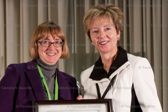 East Zorra-Tavistock Deputy Mayor Maureen Ralph (right) accepts her 25-year long-standing service award from Janet Hope, Assistant Deputy Minister of Ontario Municipal Affairs and Housing, at a conference in London in December.