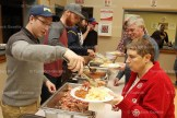 Tavistock Royals' players serve patrons at their annual Pork Barbecue held on Saturday, January 28, 2017.