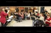 Tavistock Public School music teacher Sara Gallant conducts the Grade 7&8 class in an instrumental practice session.