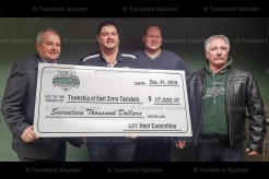 Mayor Don McKay accepts a cheque from U21 Men's Fastpitch Canadian Championship host committee co-chair Kyle Smith, Tavistock Minor Ball Association President Brian Wagler, and co-chair and Tavistock coach Kevin Zehr.