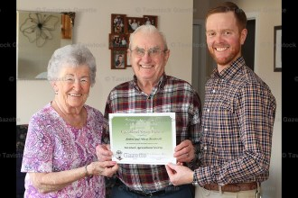 Marie and Robert Brodrecht receive the Agricultural Service Diploma award from Ag Society past president Chad Keller.