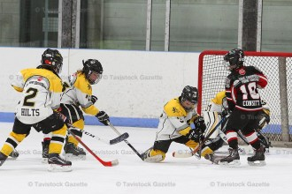 Tavistock Novice Titans defend the net during game 3 of their OMHA final vs South Huron.