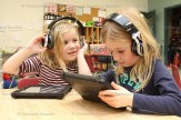 Cali Glofcheski (left) and Leah Weicker play a literacy game on the iPads.