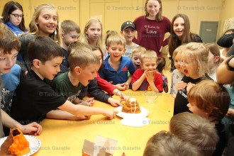 Youngsters react as a volcano erupts during their earth science and technology craft last Thursday afternoon.