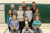 Participating in the Annual Optimist Club of Tavistock Spelling Bee are, from the left, seated: Madison Edmondson 2nd, Declen Schweyer 1st, Regan Oesch, 3rd; standing: Annabelle Hendry, Matthew Romano, Sam Roth, Naomi Ropp; and behind, Ken Mogk, John Markle and Kris Zehr.