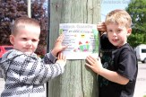 Christopher (left) and Alexander Meadows placed posters around the village for Parkfest.