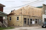 Workers build a new roof on the Zehr Insurance building on Hope Street West in Tavistock.