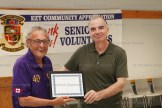 Ian MacFarlane accepts the Community Achievement Award for the Innerkip Lions Club from EZT Councillor Jeremy Smith.