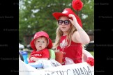 Cousins Hunter Bayer and Brooke Wilhelm aboard the Wilhelm Canucks float.