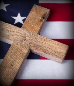 Cross on top of american flag symbolizing memorial day in United States