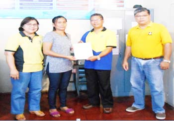 DOST TECHNOLOGY ASSISTANCE. Leila Flordelita B. Morales, owner of LFB Morales Meat Products, receives PhP154,744.00 worth of technology assistance from Department of Science and Technology (DOST) Regional Director, Dr. Armando Q. Ganal (2nd from right) together with Assistant Regional Director Paulina P. Nebrida (left) and Provincial Science and Technology Director Ramon S. Sumabat (right) in a simple ceremony held at the Ilocos Sur Science and Technology Center (ISSTC), Tamag, Vigan City on June 8, 2017. (Donna M. Flores, ISSTC Ilocos Sur)