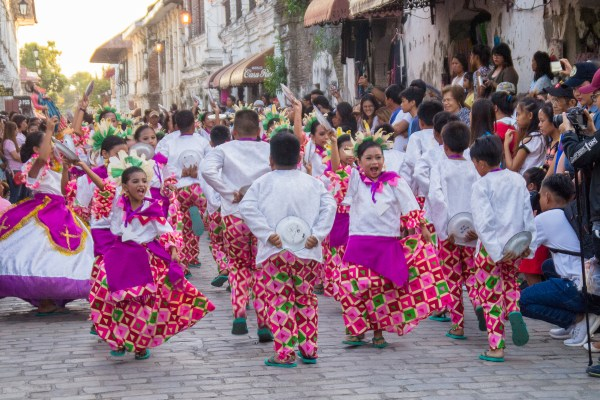 Calle Crisologo, the cultural heart of the heritage city of Vigan, became alive with the sounds of parade bands and the shouts of these young street dancers. Wearing colorful native costumes and dancing to the beat of the drums, they entertained the throngs of people, both local and tourists, that crowded the sidewalks of this historical street. Photographed by Jasper Espejo.