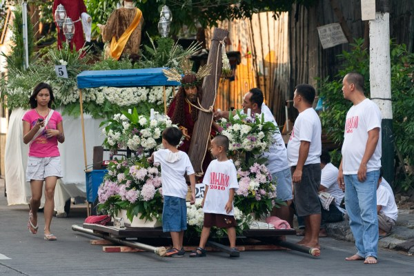 FILE PHOTO. A group of men and young kids prepare a carroza for the Holy Week procession, Makati City, 2010 (photo by Jasper A. Espejo)