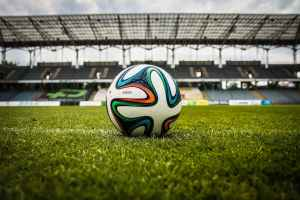 multicolored soccer ball on green field