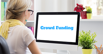 A woman browsing a crowd funding website