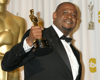 Forest Whitaker holding Academy Award