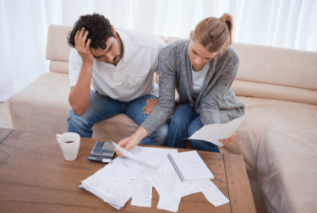 young couple working on tax forms