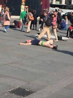 Man lying in Trafalgar Square
