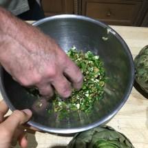 We stuffed this mixture of stems, parsley, garlic, salt and pepper in between the artichokes' leaves.
