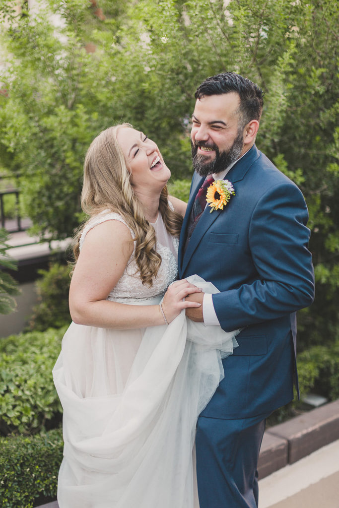 newlyweds laugh with Las Vegas wedding photographer Taylor Made Photography