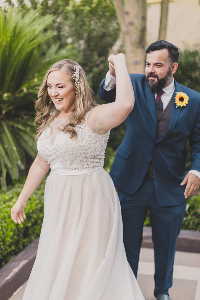 groom twirls bride during first look at MGM Grand with Taylor Made Photography