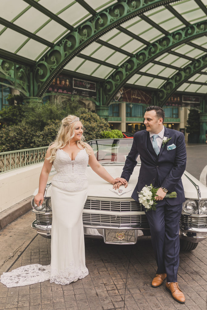 bride and groom with white Cadillac on wedding day in Las Vegas