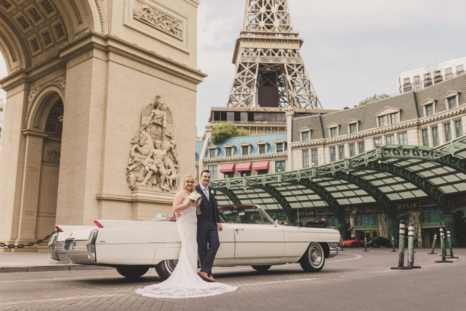 Las Vegas wedding portraits by white Cadillac by Taylor Made Photography