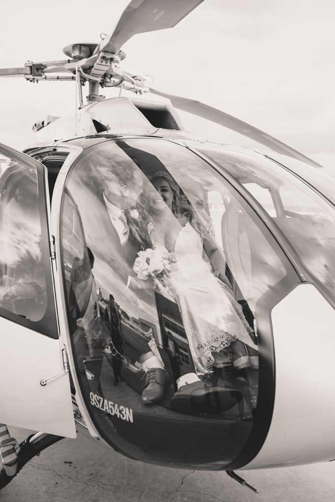 Taylor Made Photography captures bride and groom in the helicopter