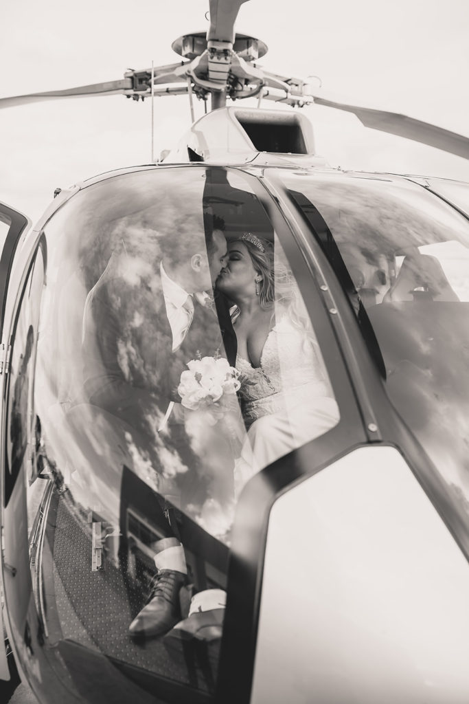 newlyweds kiss inside helicopter ride