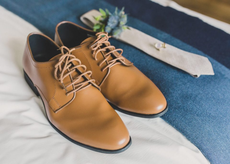 groom's brown shoes and white tie photographed by Taylor Made Photography