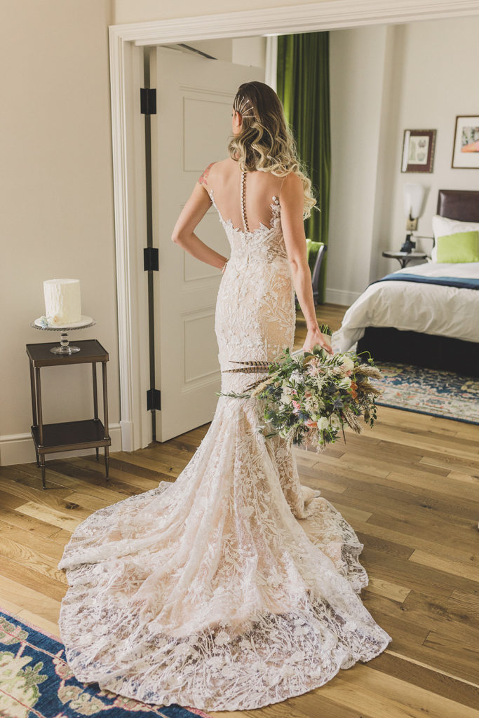 bridal portrait of vintage lace wedding gown in Las Vegas hotel by Taylor Made Photography