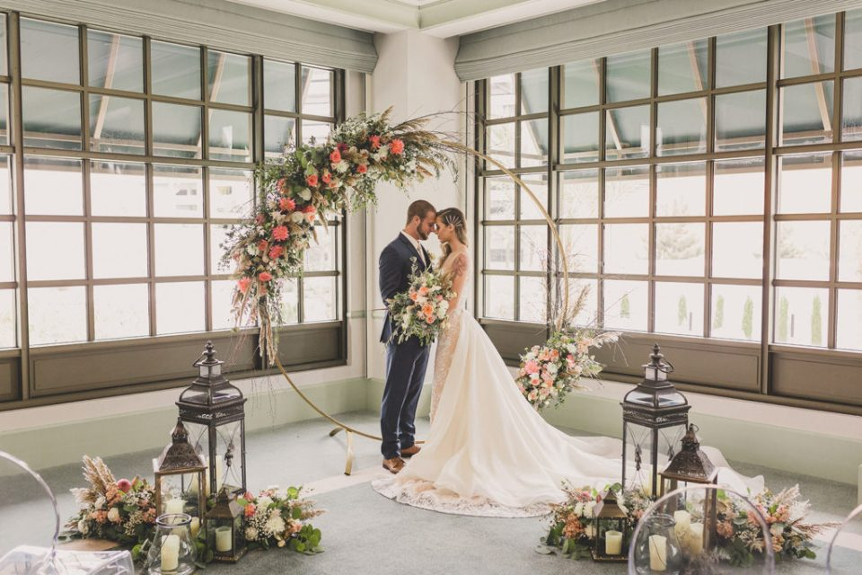 bride and groom pose during vintage boho styled shoot at Park MGM