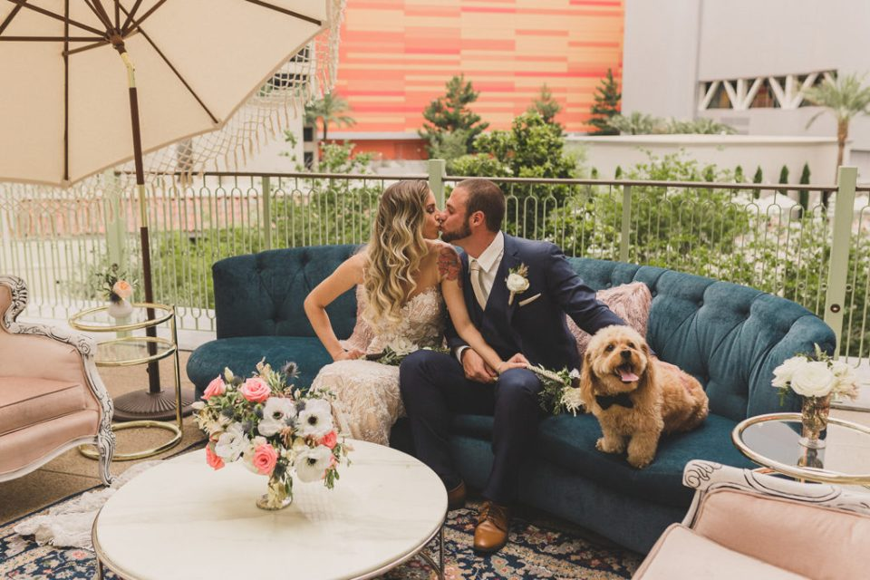 newlyweds kiss on Central Park Terrace at Park MGM photographed by Taylor Made Photography