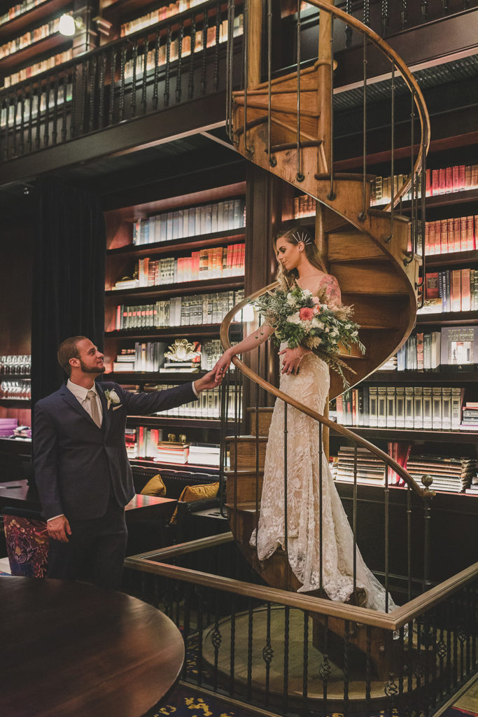 bride and groom pose on staircase in Park MGM by Taylor Made Photography