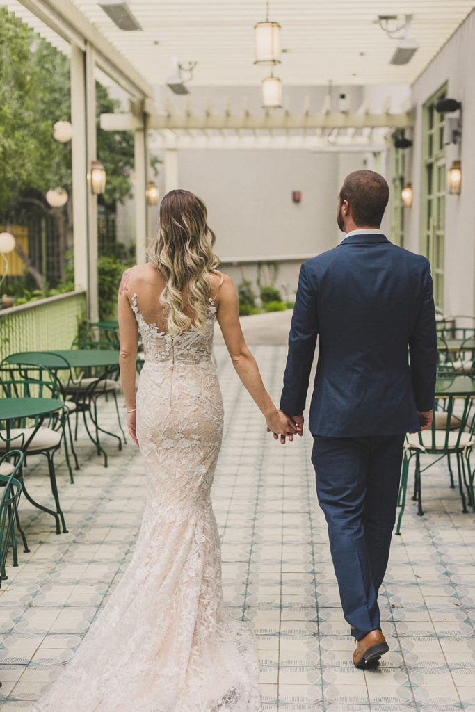 bride and groom walk down patio in Las Vegas photographed by Taylor Made Photography