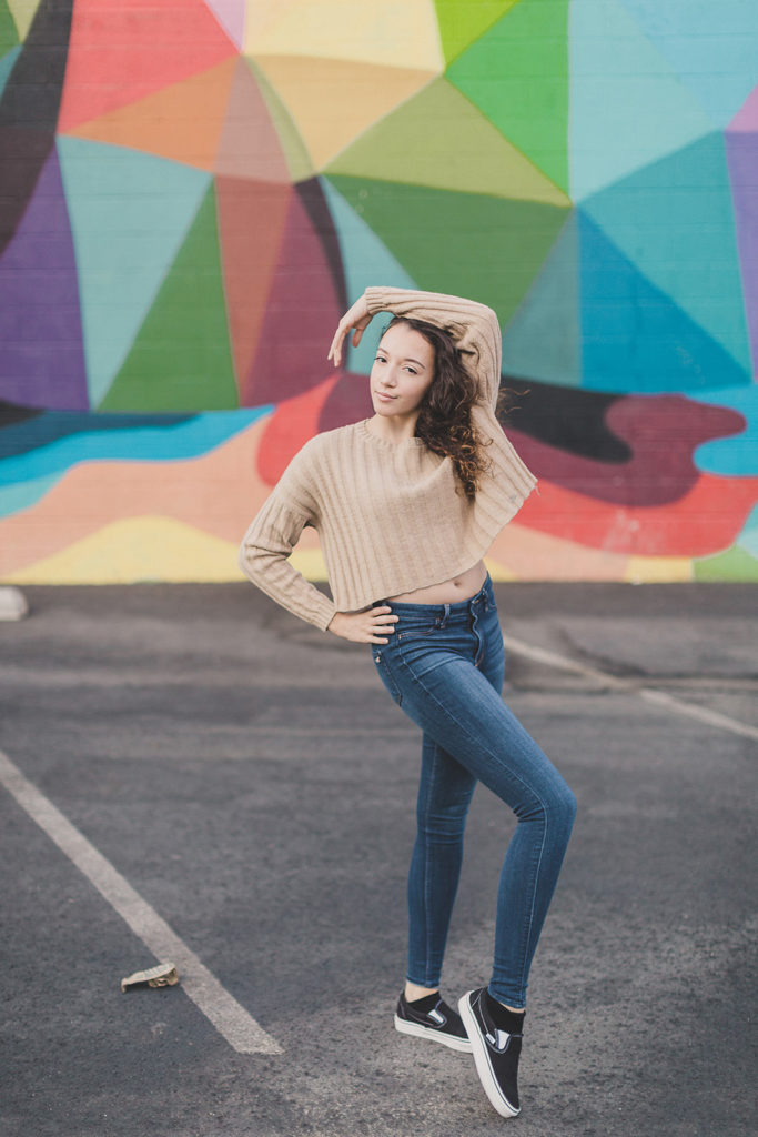 senior portraits by colorful Las Vegas mural with Taylor Made Photography