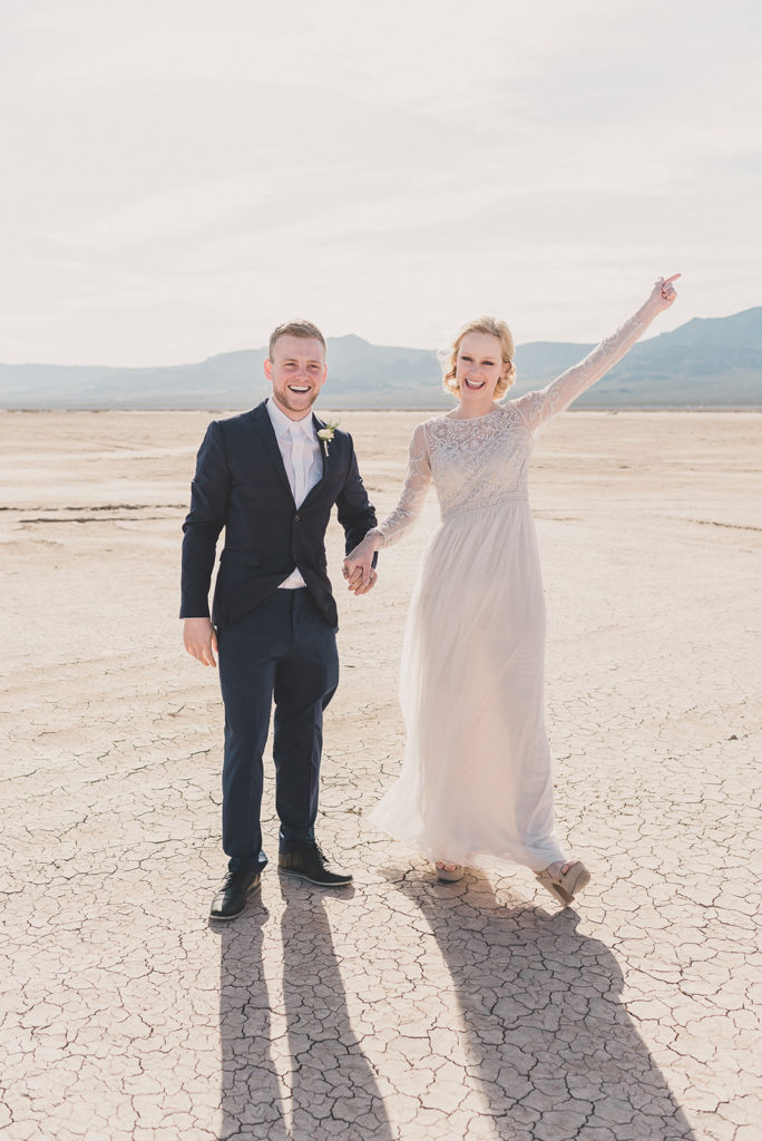 newlyweds cheer after ceremony in Boulder City NV with Taylor Made Photography