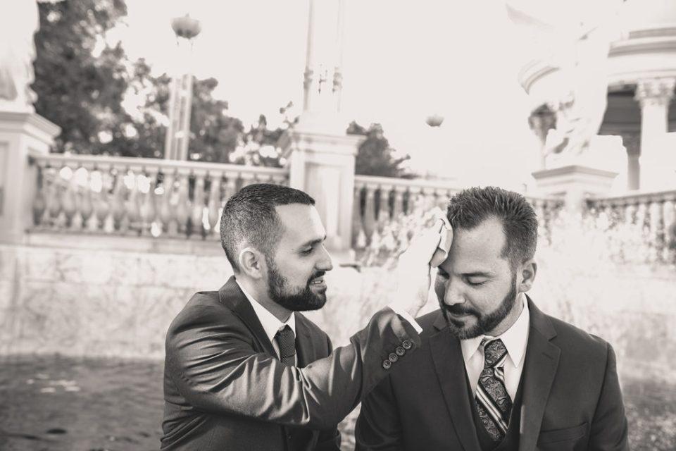 tender moment between grooms during elopement in Las Vegas