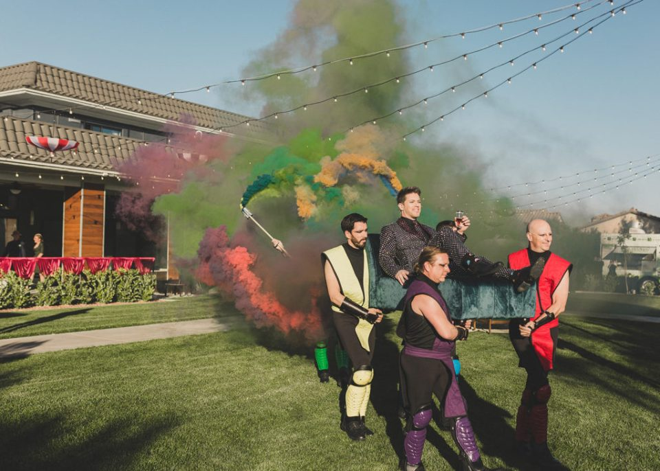 Taylor Made Photography photographs groom entering wedding ceremony with colored smoke