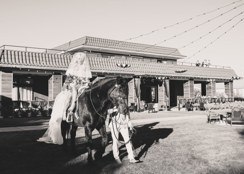 bride enters wedding ceremony at Lotus House on horseback photographed by Taylor Made Photography
