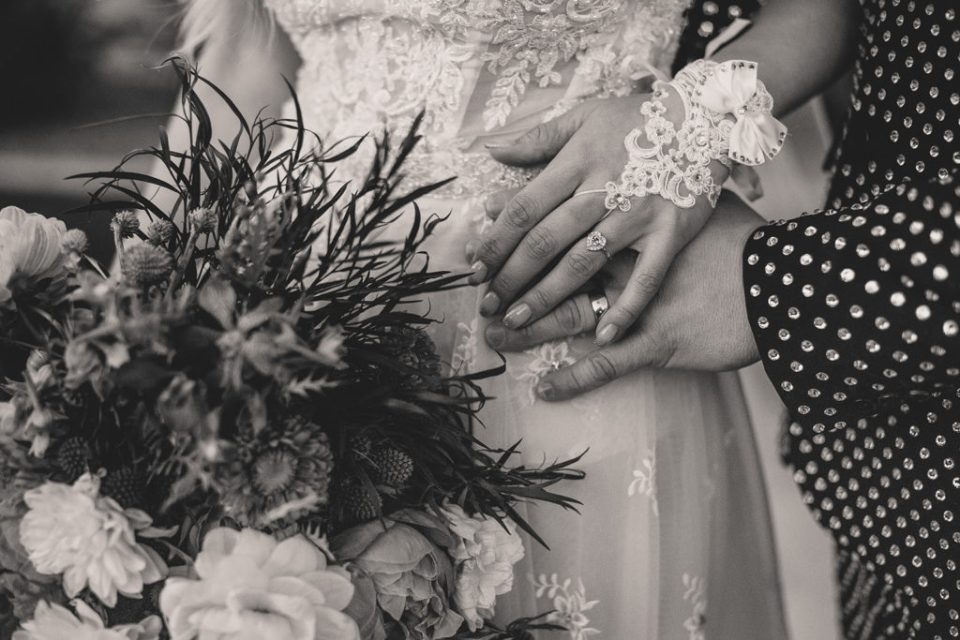 Taylor Made Photography captures bride and groom's rings
