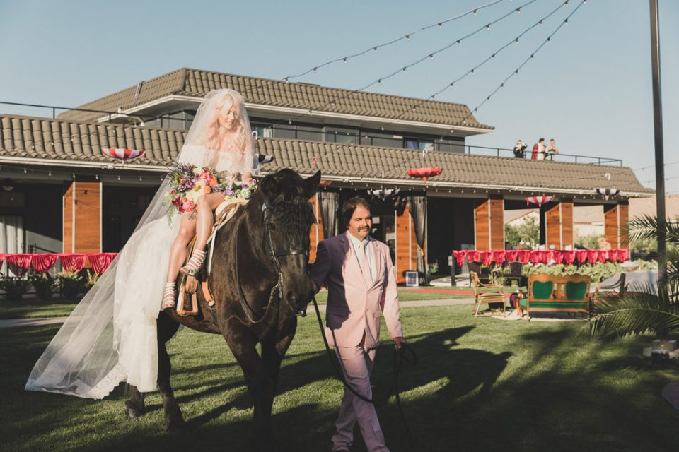 Annalee Belle enters Las Vegas ceremony on a horse photographed by Taylor Made Photography
