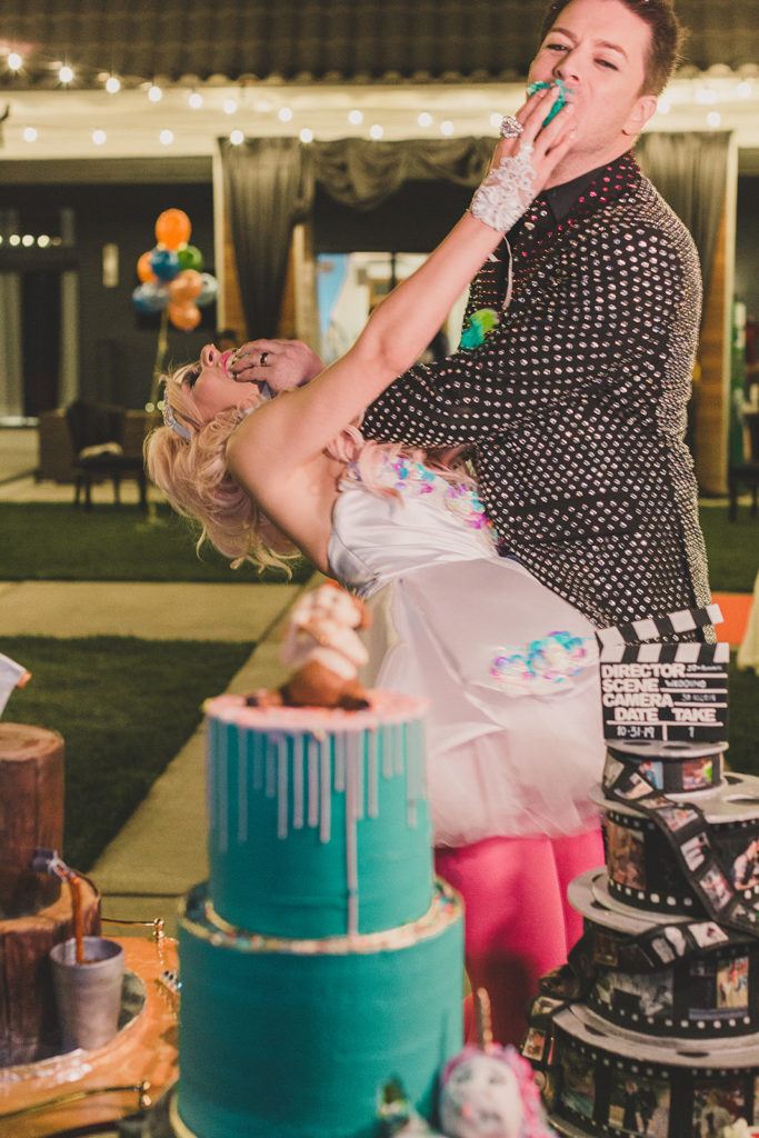 bride and groom feed each other wedding cake in Las Vegas photographed by Taylor Made Photography