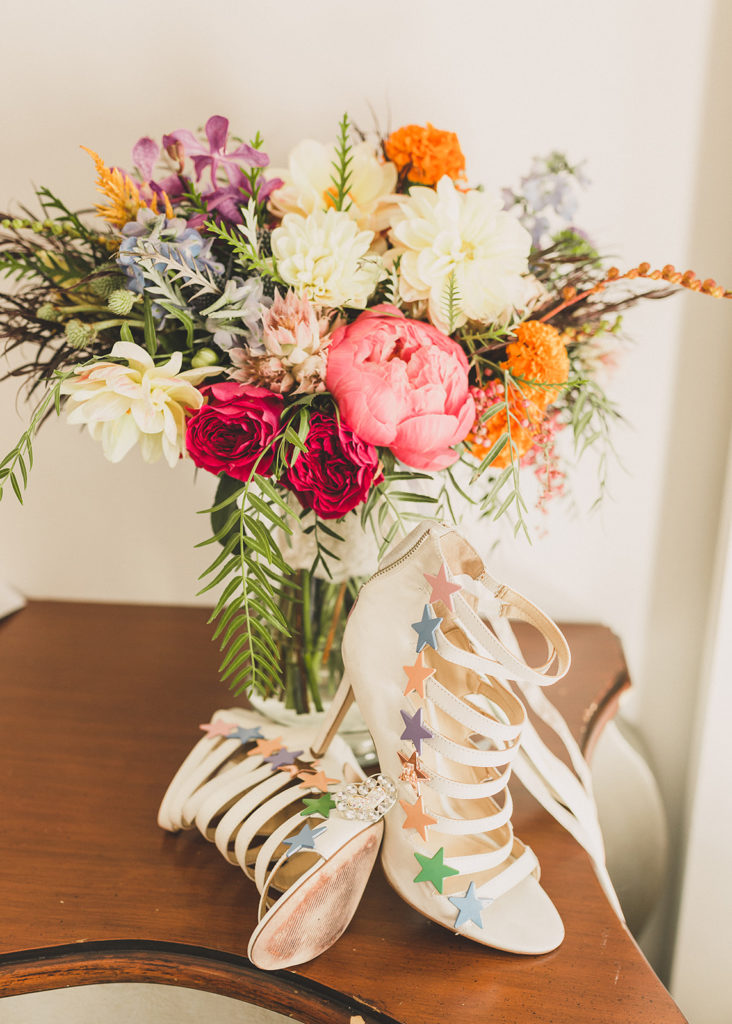 bride's colorful wedding shoes and bouquet photographed by Taylor Made Photography