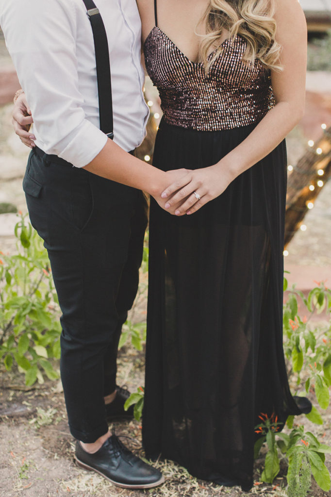 bride holds groom-to-be's hand during engagement session